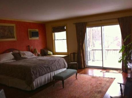 Henniker House's spacious Pear Room has a king-size and a twin bed and a claw-foot tub and shower in the bathroom.